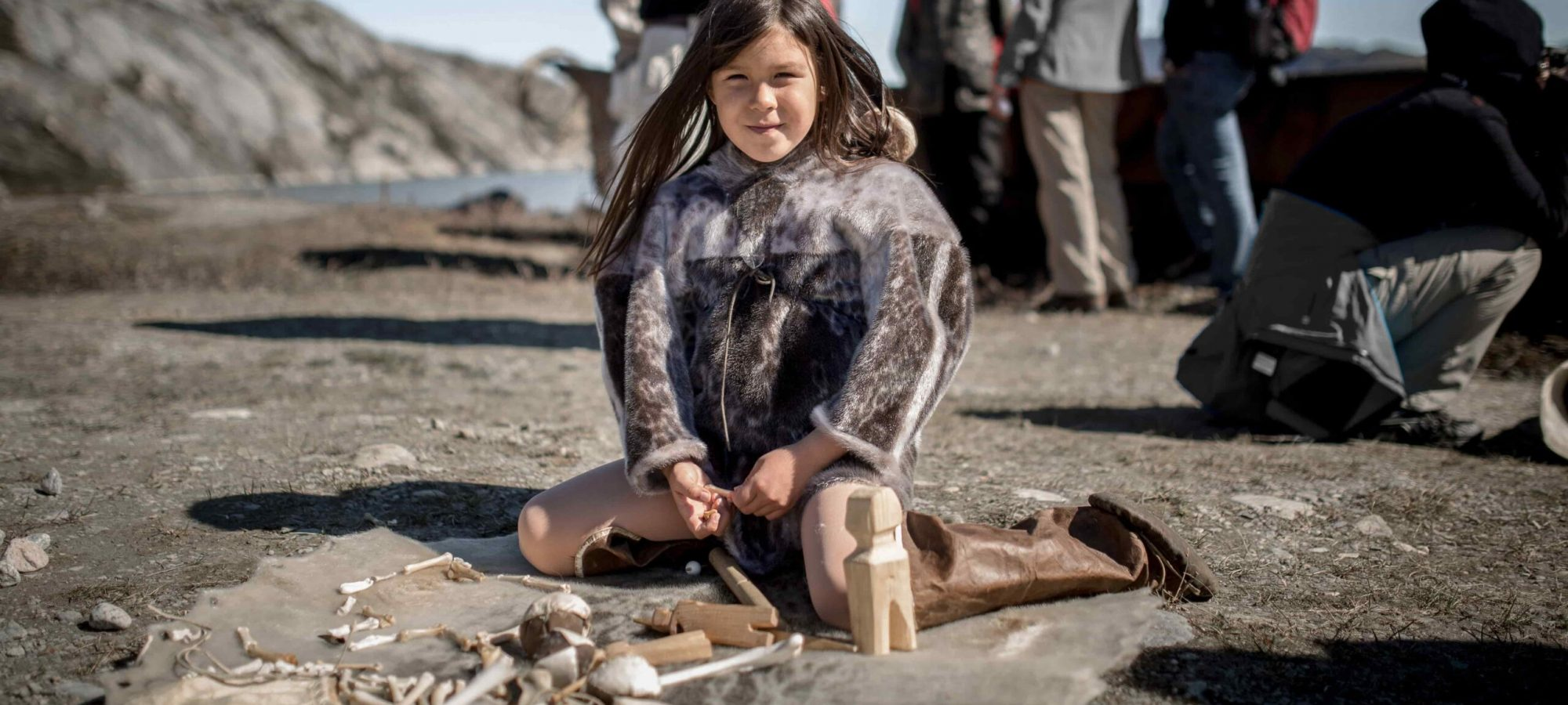 A young girl at play at the living village exhibition at Qasigiannuit Museum in Greenland copy-min