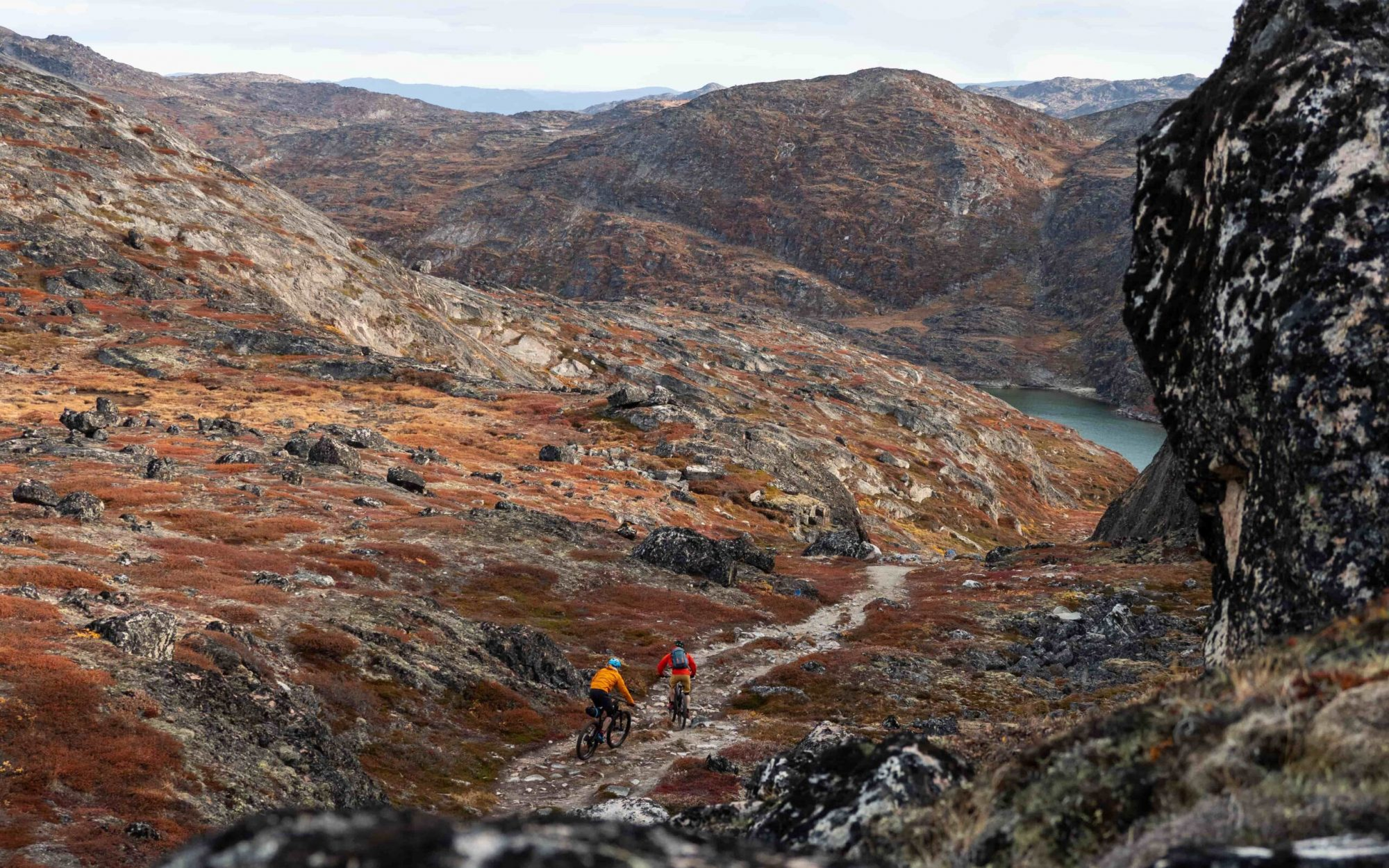 Bikers on blue trail eastern section. Photo - Ben Haggar, Visit Greenland-min