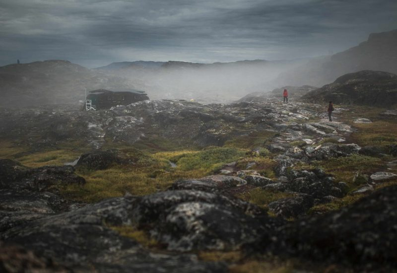 Hikers in the fog on a trail near Ilulissat in Greenland-min