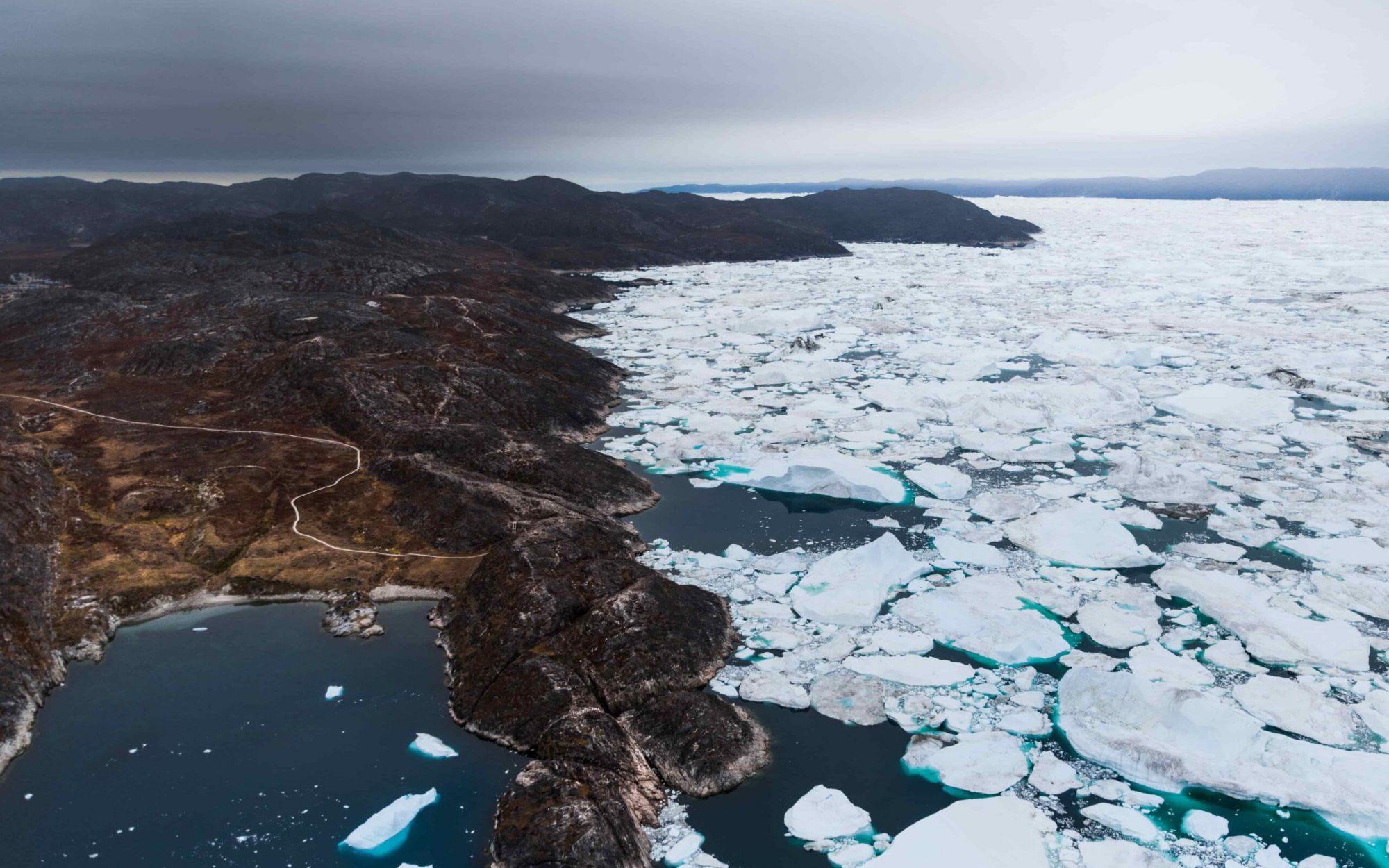 Hiking Kangia coastline trails. Photo - Stian Klo , Visit Greenland-min
